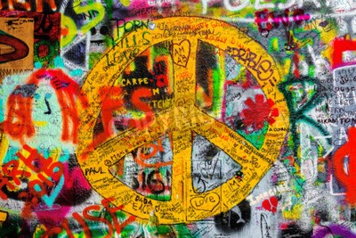 Fototapete PRAGUE, CZECH REPUBLIC - MAY 21, 2015: Peace Sign on Famous John Lennon Wall on Kampa Island in Prague filled with Beatles inspired graffiti and lyrics since the 1980s.