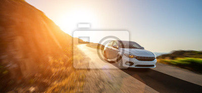 Fototapete rental car in spain mountain landscape road at sunset