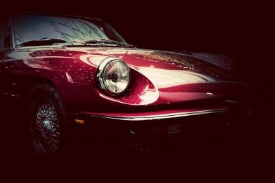 Fototapete Retro classic car on dark background. Vintage, elegant