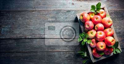 Fototapete Ripe Apples In Wooden Basket On The Rustic Table
