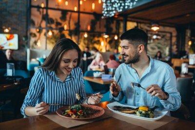 Fototapete romantic couple in restaurant having lunch
