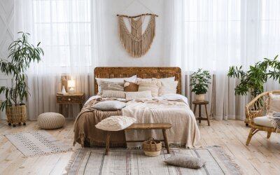 Fototapete Rustic home design with ethnic boho decoration. Bed with pillows, wooden furniture