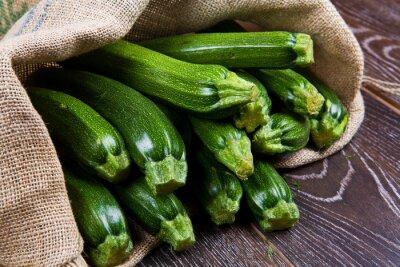 Fototapete Sacco di tela pieno di zucchine
