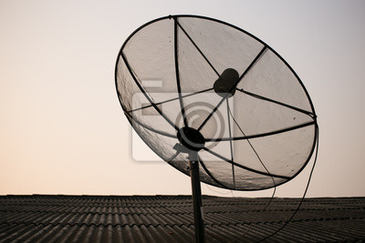 Satellite dish on the roof of rural house in Thailand.