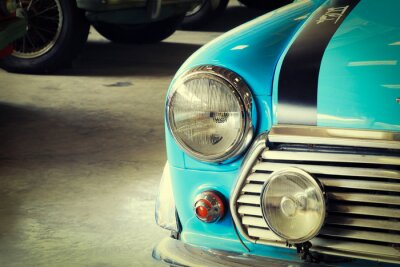 Fototapete Schließen Sie oben von der Front eines weichen grünen Vintagen Autos