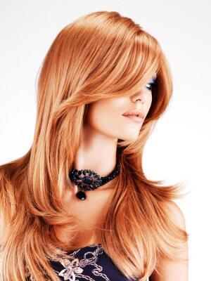 Fototapete Schöne Frau mit langen roten Haaren