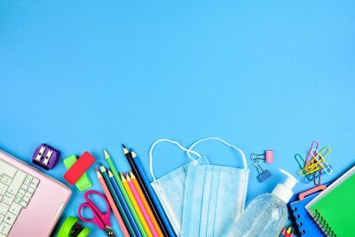 Fototapete School supplies and coronavirus prevention items. Bottom border on a blue paper background. Back to school during pandemic concept.