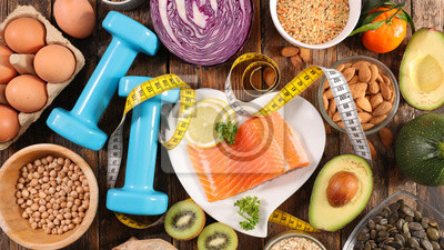 Fototapete selection of diet food, salmon with dumbbell and healthy food