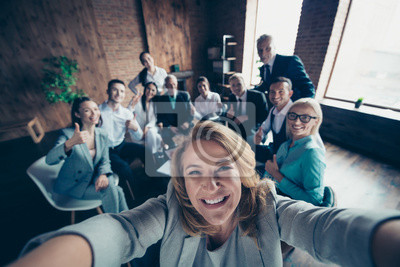 Fototapete Self-portrait above high angle view of nice stylish cheerful glad positive director company staff showing thumbsup yes goal achievement recommend modern industrial loft interior work place open space