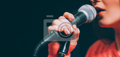 Fototapete Singer at microphone. Woman singing and holding mic. Female vocal talent. Music show recital.