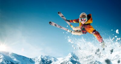 Fototapete Skiing. Jumping skier. Extreme winter sports.