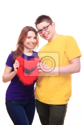 Smiling two people in love holding heart