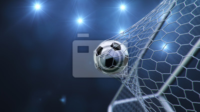 Fototapete Soccer ball flew into the goal. Soccer ball bends the net, against the background of flashes of light. Soccer ball in goal net on blue background. A moment of delight. 3D illustration
