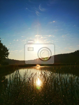 Sonne morgens am See
