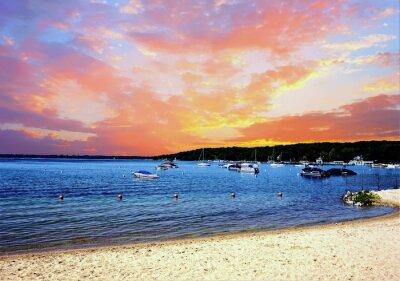 Fototapete Sonnenaufgang über einem Resort