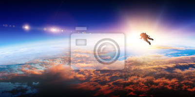 Fototapete Spaceman and planet, human in space concept