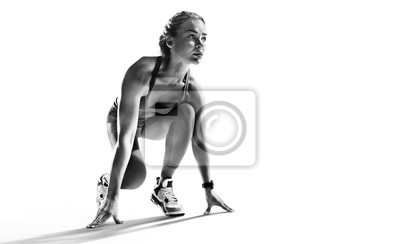 Fototapete Sports background. Runner on the start. Black and white image isolated on white.