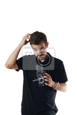 Stattlicher Mann mit Vintage-Foto-Kamera der Kopf löscht