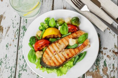 Fototapete steak grilled salmon with vegetables on a plate