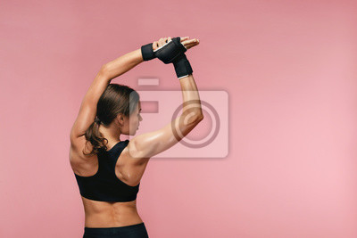 Fototapete Stretch. Sport Woman Stretching Before Training