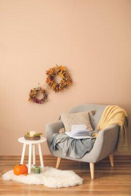 Fototapete Stylish interior of living room with autumn decor