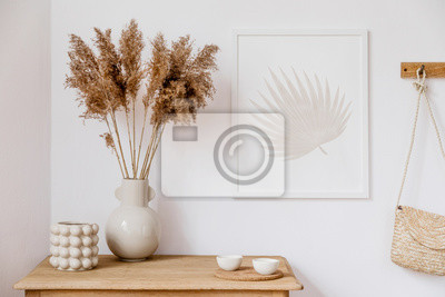 Fototapete Stylish korean interior of living room with brown mock up poster frame, elegant accessories, flowers in vase, wooden shelf and hanging rattan bag. Minimalistic concept of home decor. Template. Decor.