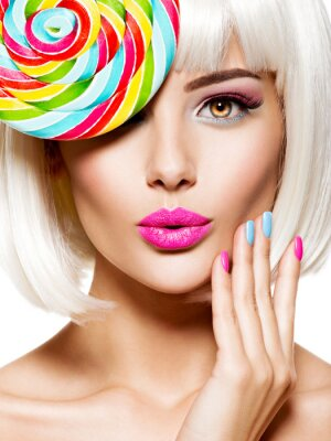 Fototapete Surprised face of a pretty woman  with multicolor nails and pink lips