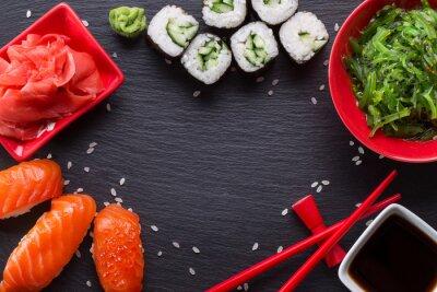 Fototapete Sushi und Brötchen auf einem Schiefertisch