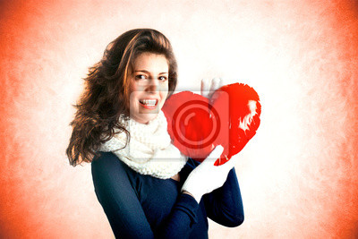sweet girl in love holding a red heart