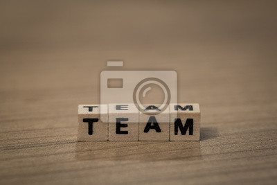 Team in wooden cubes