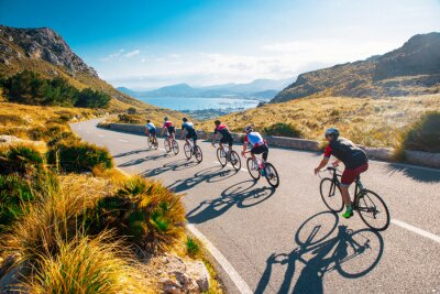 Fototapete Team sport cyclist photo. Group of triathlete on bicycle ride on the road at Mallorca, Majorca, Spain.