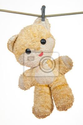 Teddybär hängen auf einer Schnur zu trocknen