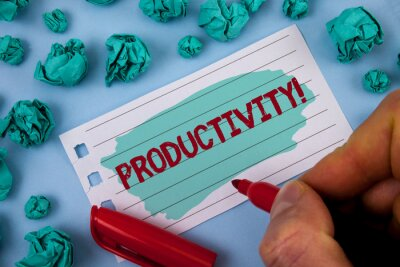 Text sign showing Productivity Motivational Call. Conceptual photo Effective work Great perfomance Success focus written by Man Painted Notepad Paper holding Marker plain background Paper Balls.