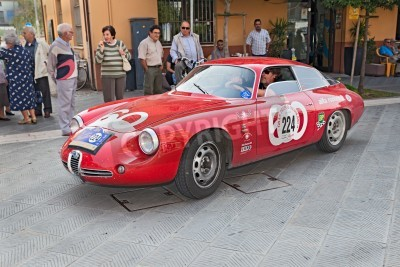 the crew h. lingner h. stoppel on a vintage racing car alfa romeo