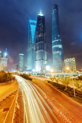 Fototapete the light trails on the modern building background in shanghai c