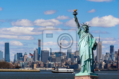 Fototapete The Statue of Liberty over the Scene of New york cityscape river side which location is lower manhattan,Architecture and building with tourist concept
