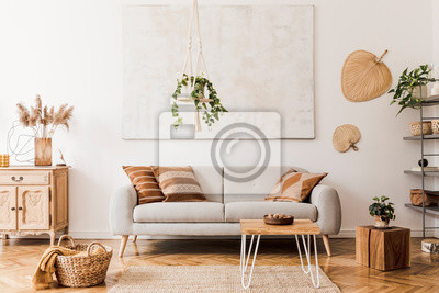 Fototapete The stylish boho compostion at living room interior with design gray sofa, wooden coffee table, commode and elegant personal accessories. Honey yellow pillow and plaid. Cozy apartment. Home decor