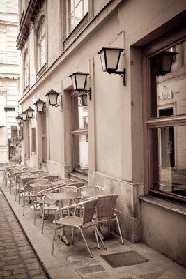 Fototapete Tische und Stühle in einem Café