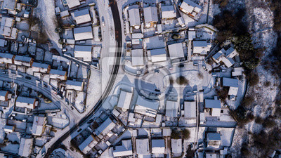 Fototapete Top down aerial view of roads and houses covered in fresh snowfall (Ebbw Vale, Wales, UK)
