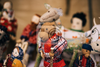 Fototapete Traditional Russian stuffed on pancake week. teddy bears for the traditional Slavic holiday - Shrovetide. Homemade dolls with hay for children.