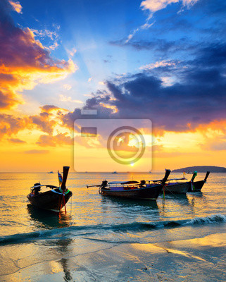 Fototapete Traditional thai boats at sunset beach