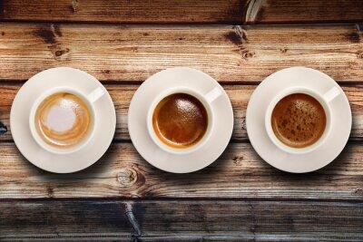 Fototapete tris di caffè su fondo legno