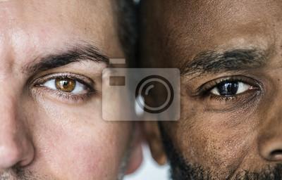 Fototapete Two different ethnic men's eyes closeup