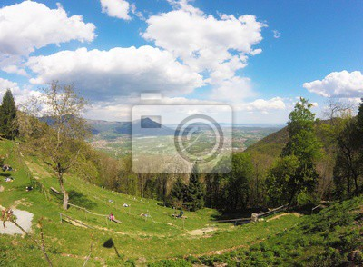 Val di susa, beautiful view of the green valley with people standing ...