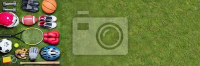 Fototapete Various Sport Equipments On Grass