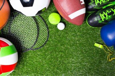 Fototapete Verschiedene Sport-Tools auf Gras