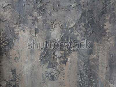 Fototapete Verzierung auf einer grauen Betonmauer