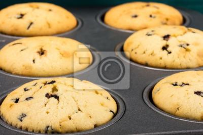 Fototapete viele frisch gebackene Muffins in Backform