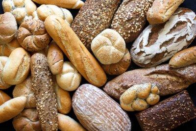Fototapete Viele gemischte Brotsorten und Brötchen von oben geschossen.