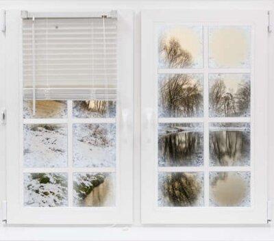 Fototapete view through the frozen window on the winter landscape sun rays